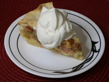 Rhubarb Custard Pie with whipped cream.