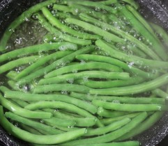 Boil green beans four minutes.