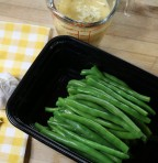 Arrange cooked green beans in an air-tight container.