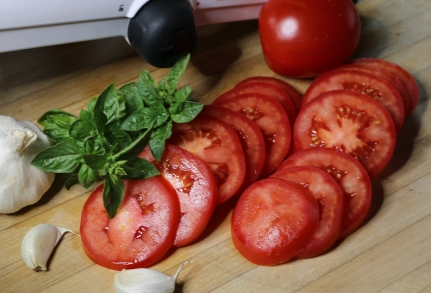 Slice fresh tomatoes.