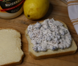 Spread fillling on buttered bread.