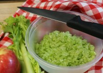 Finely chop celery.
